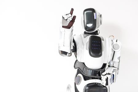 ロボットは目に見えないタッチ スクリーンを使用します。 写真素材