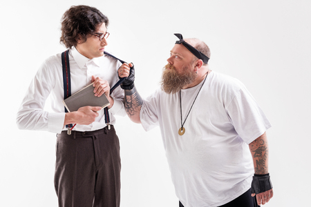 Mad thick male hipster molesting weak guy