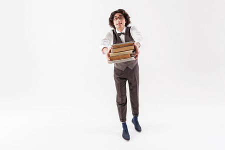 Lets read together. Full length portrait of happy young male bookworm is showing abundance of volumes with excitement. Isolated and copy space