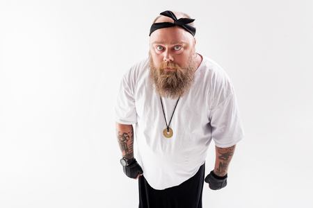 Bully fat guy staring at someone Reklamní fotografie - 80596958