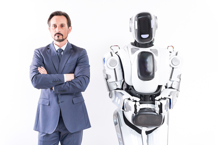 Adult businessman and robot are demonstrating self-control Stock fotó