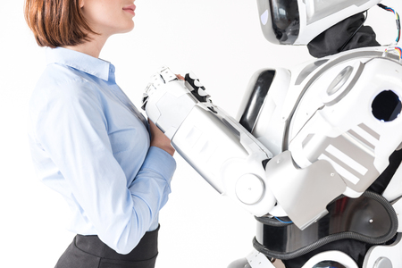 Pleasant girl is standing with android