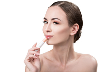 Cheerful attractive girl using visage make-up Stock Photo