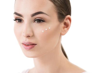 moisturize: Cheery beautiful girl using decorative cosmetics Stock Photo