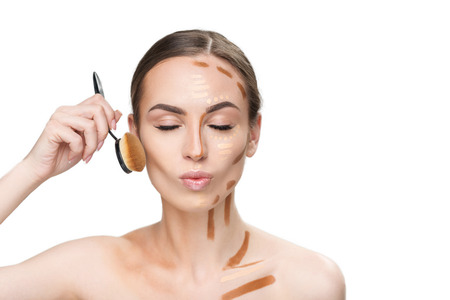 Concentrated young female person keeping cosmetic brush Stok Fotoğraf