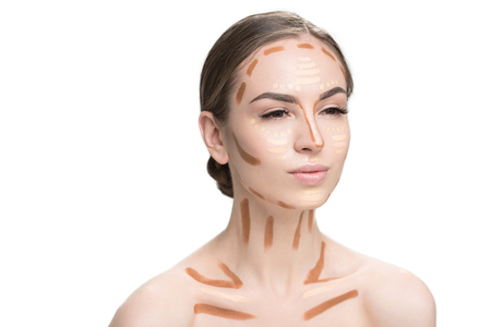 Attentive woman has foundations on visage