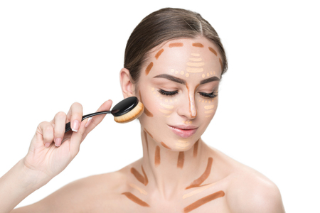 Happy young woman creating facial features Stock Photo