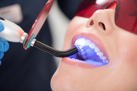 Doctor watching at oral cavity of client Stock Photo