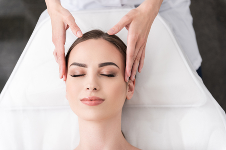 Relaxing facial massage at spa salon Фото со стока