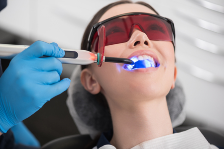 odontology: Doctor examining mouth of outgoing female Stock Photo