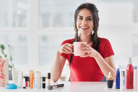 Happy woman dealing in cosmetology