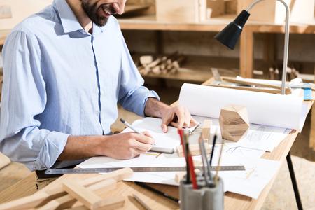 Carpenter is laboring in his workshop