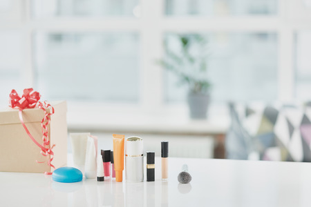 Different cosmetology on desk at home