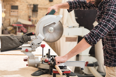 Energetic woodworker is toiling with pleasure