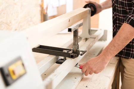 professionally: Carpenter is regulating professionally equipment