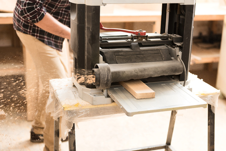 specialized job: Woodworker is laboring in his workshop