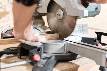 specialized job: Woodworker is laboring on professional machine