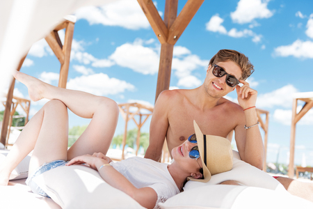 Cheerful youthful lady and guy having rest on summer resort Stock Photo