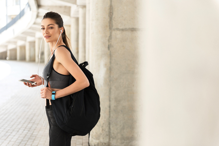Cheerful slim young woman going for sports Stock Photo