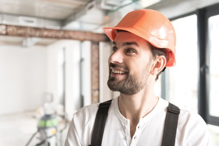 Outgoing construction worker looking at plafond