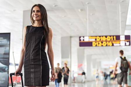 Elegant happy lady is waiting for flight