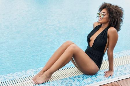 Happy youthful african girl relaxing on summer resort 版權商用圖片