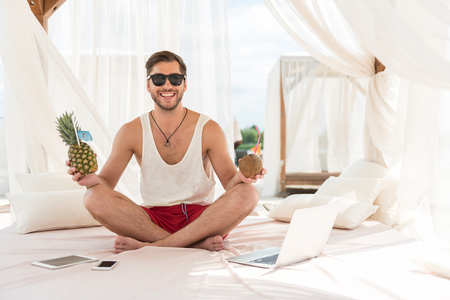 Jolly young bearded guy resting on summer resort