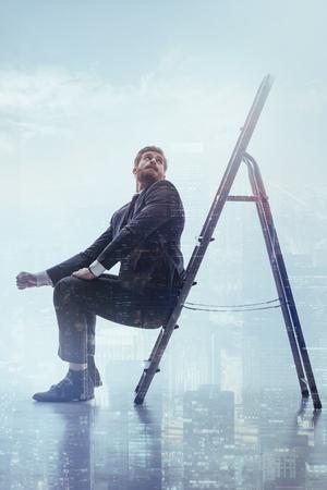 Dreamful businessman desiring higher business position