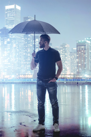 serine: Serine man holding umbrella in abstract metropolis