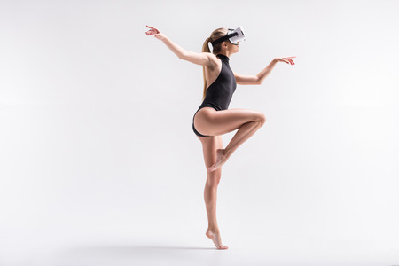 Pensive youthful girl dancing in goggles Stock Photo