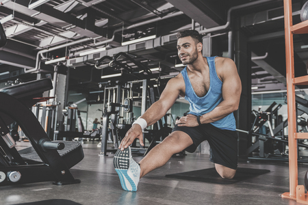 Satisfied bearded athlete taking physical exercise Stock Photo