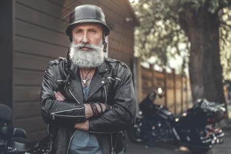 Cheerful smiling old man in helmet Stok Fotoğraf