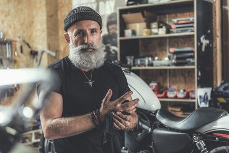 Assured old man in garage Stok Fotoğraf - 83988866