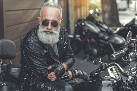 Serious old male person using motorbike Stok Fotoğraf - 84120462