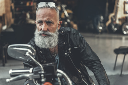 Tired glance of old man on bike Banco de Imagens