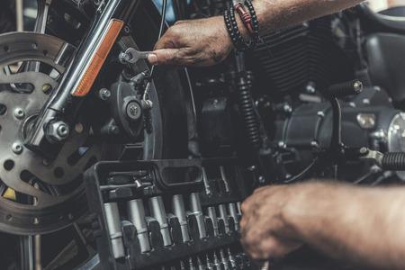 dirty: Man using tools for repair motorbike