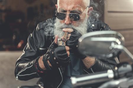 Serious elder man going to smoke Stock Photo