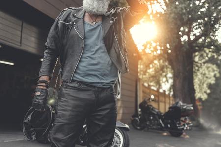 Bearded old man near garage