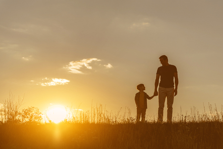 Friendly family walking on grass field together Stockfoto
