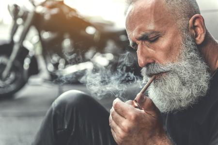 Elder man going to smoke Banco de Imagens