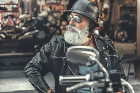 Interested old man ready for ride