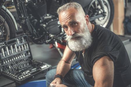 Assured aged man in workshop