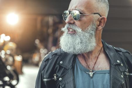 Assured aged biker in goggles