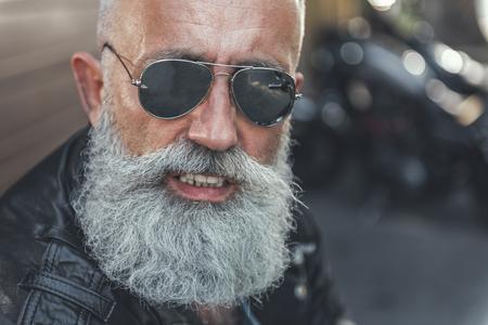 Cheerful smiling elder man in sunglasses