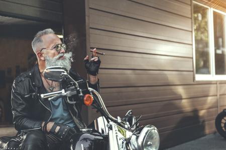 Nice old man keeping smoke