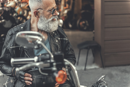Interested old man on motorcycle