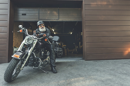 Cool elder man on motorbike Stok Fotoğraf