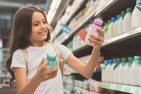 Outgoing child choosing dairy product