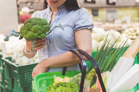 Girl arms holding fresh branching cabbage Stock fotó