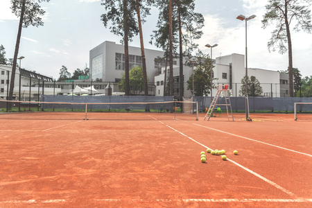 Lot of little yellow spheres on court Stock Photo